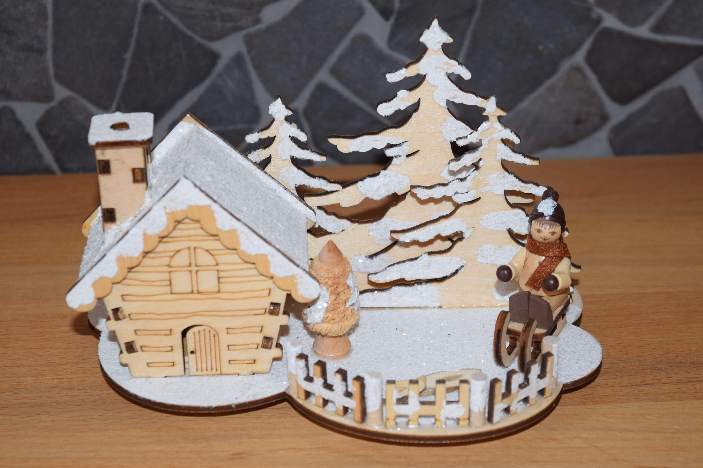 Räucherhaus - Winterkind mit Schlitten 18 * 11 * 12 cm